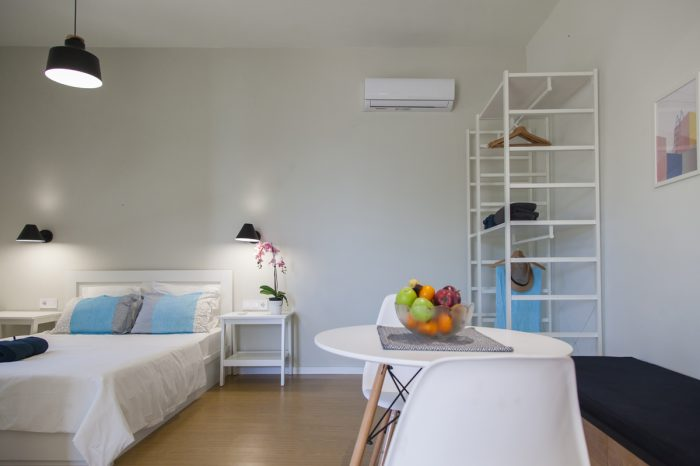 ligia-bay-apartments-lefkada-greece-ground-floor-apartment-one-dining-table-double-bed-kitchenette-wardrobe-stool
